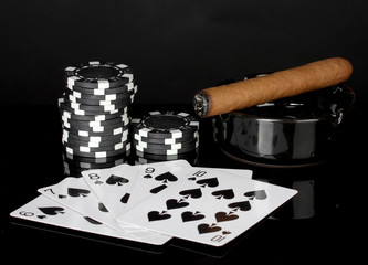 straight flush with poker chips on black background