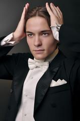 Elegant young man in suit. Fashion men