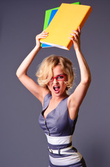 angry businesswoman with folders