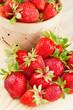 strawberries in basket on wooden board
