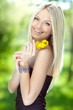 Portrait of a beautiful young woman with yellow flowers
