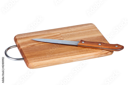 Wooden board with kitchen knife.