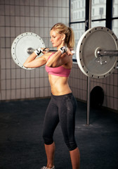 Fitness Woman Lifting Heavy Weight
