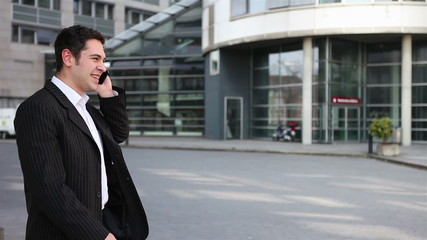 Business man laughing on cell phone