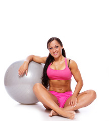 Portrait of sexy woman with fitball
