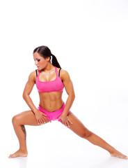Portrait of joga treiner posing in studio in pink sportwear