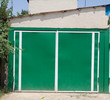 green garage door of the house
