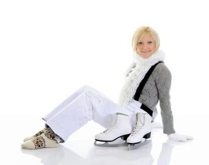 Beautiful girl puts on skates
