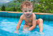 little boy in the pool