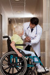 Doctor with Patient on Wheel Chair