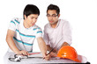 Two Architects Discussing on Blueprints