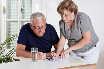 Mature Couple playing Scrabble Game