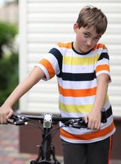 Beautiful boy with a bike