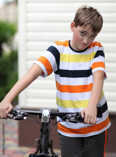 Beautiful boy with a bike
