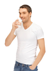 man in white shirt with glass of water