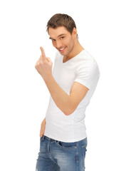 man in white shirt making inviting gesture