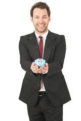 business mann mit sparschwein