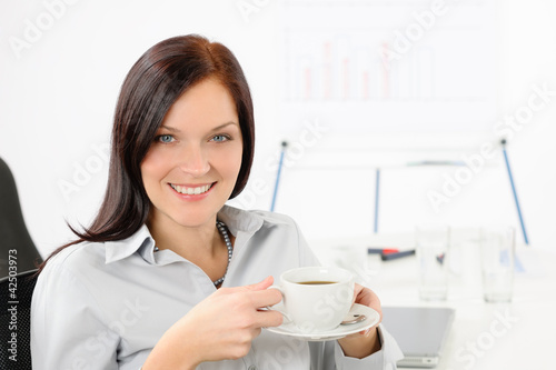 Attractive businesswoman drink coffee