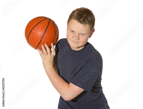Teenager playing with a basketball