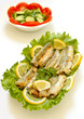 Grilled Capelin  with salad, lemon and vegetables