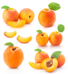 Apricot with green leaf and cut, isolated on white background