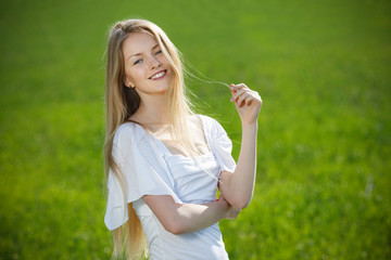 Closeup of young beautiful smiling blond woman