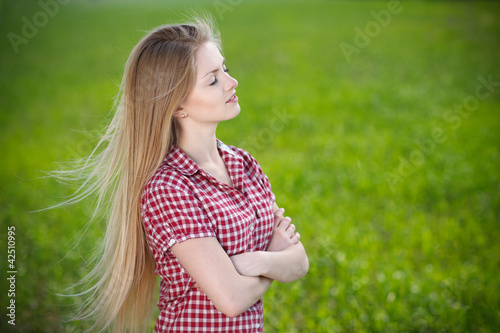 Female enjoying fresh air with closed eyes