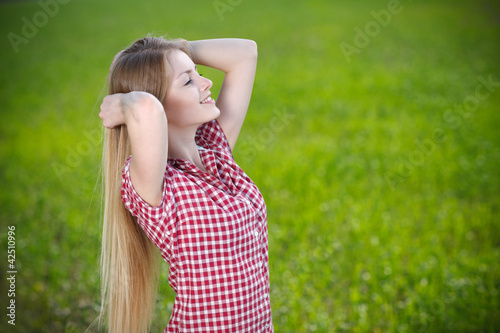 Young woman relaxing with hands behind her head