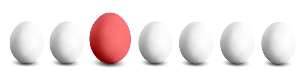 großes rotes Ei in einer Reihe weißer Eier