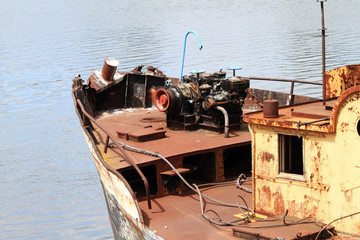 Old Motored ship in port on the sea