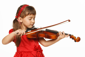 Girl playing the violin with closed eyes, over white background