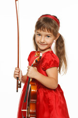 Adorable girl standing with violin, over white background