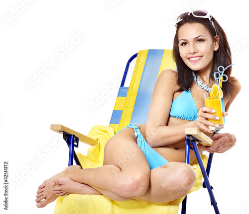 Girl in bikini drink juice through  straw.