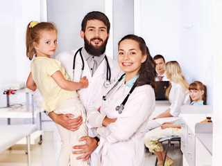 Doctor with child in hospital.