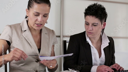 Manager with punk businesswoman working together in the office