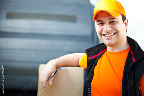 Smiling guy delivering a box