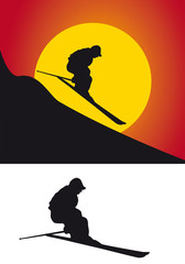 The silhouette of skiers