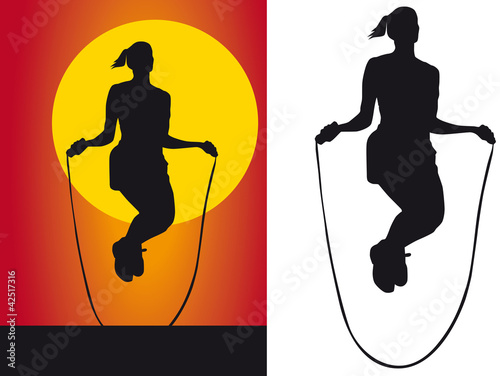 Silhouette girls jump rope