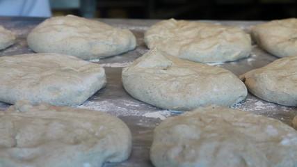 Baker preparing dough inside a bakery