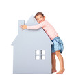 Cute little girl holding a big house icon on white