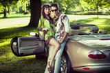 Handsome couple in cabriolet