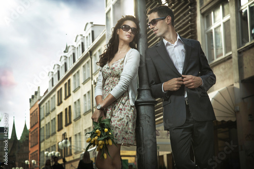 Adorable couple on the middle of a promenade