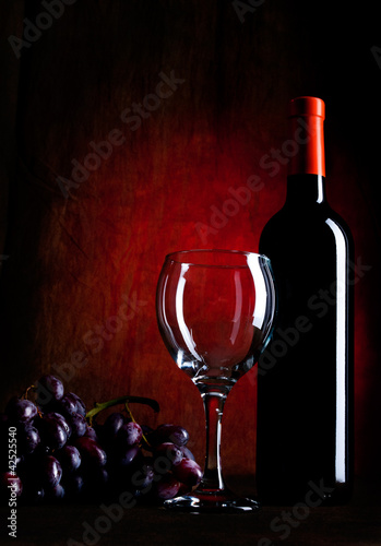 Wine Bottle With Glasses And Grapes