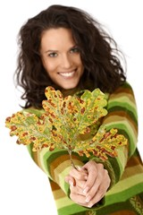 Autumn tree leaf and smiling woman