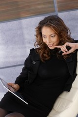 Young elegant woman with tablet pc