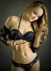 sensual blond woman in lingerie,  dark background