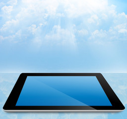 cloud computing concept tablet pc with cloudy sky
