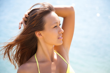 Portrait of young attractive woman having good time in the beach