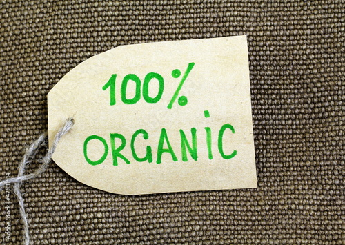 Organic label on the natural  burlap background