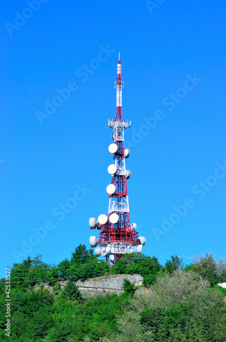 antenna tower transmissions in the blue sky